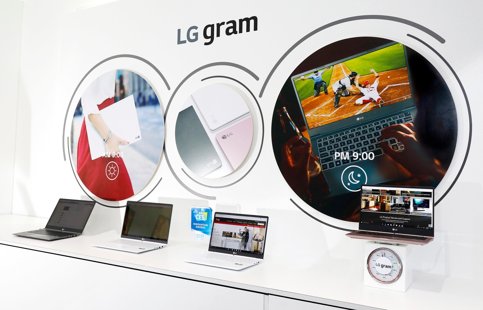 Close view of the LG gram laptop display zone with a model of its lineup being weighed to demonstrate its light weight at the LG display zone at CES 2017