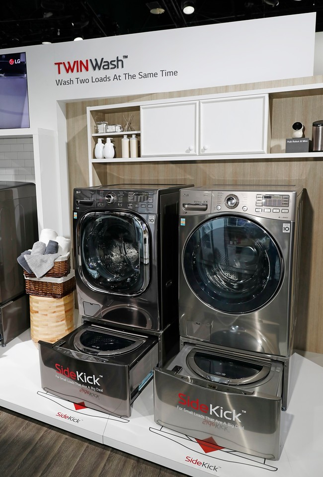 Two LG TwinWash washing machines with the SideKick feature are on display at LG's CES 2017 booth.