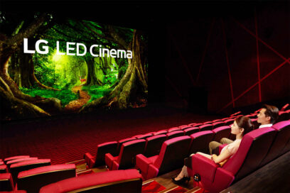 A woman and a man are looking at the LG LED Cinema Display as it produces a colorful nature scene at Showtime Cinemas, Taiwan's leading movie theater company