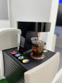 The capsule coffee machine in the IONIQ Concept Cabin making a cup of coffee for a passenger