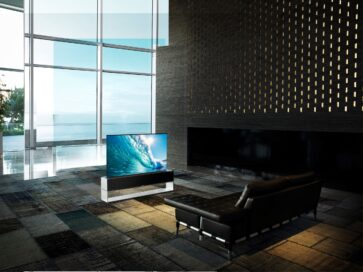LG SIGNATURE OLED R positioned inside a modern living room in its Full View mode, bringing the realistic viewing experience of watching ocean waves crashing