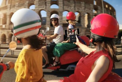 Four friends ride scooters in front of the Colosseum while a passenger uses LG WING's unique camera capabilities to capture the action perfectly