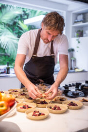 Chef Darren Robertson making the finishing touches to his dishes at Australia's LG SIGNATURE Home