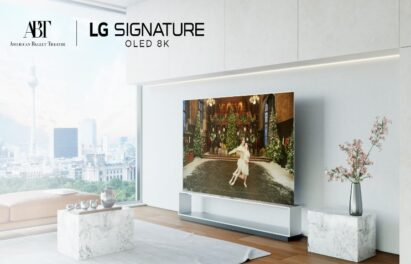 LG SIGNATURE OLED 8K TV showcases the American Ballet Theater's performance of The Nutcracker inside a bright modern living room with a beautiful view of the city