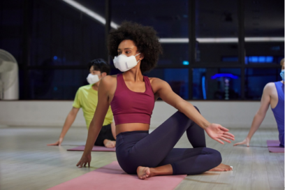 People wearing LG PuriCare™ Wearable Air Purifier during a Yoga session to enjoy the clean and fresh air while protecting themselves.