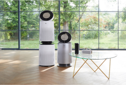 The four LG Purifier models ranging from the residential to handy portable model displayed in an open room with a large window overlooking the garden.