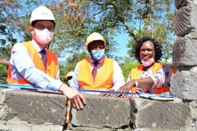 Kim Sa-nyoung, LGE's managing director for East and Central Africa, joins deputy governor of Machakos County, Eng. Francis Maliti, and national director of Habitat for Humanity Kenya, Ruth Odera, at the construction site of Machakos School for the Deaf's new library.