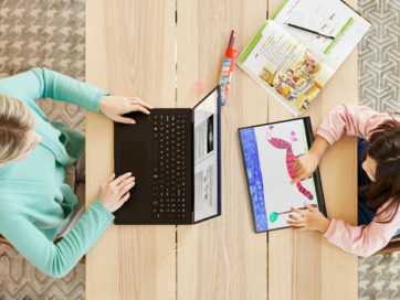 A woman using LG gram to do some work at her desk with her daughter who is drawing a picture of an animal on LG gram 2-in-1.