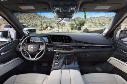 An image showing the front interior design of a Cadillac with LG's infotainment system on show
