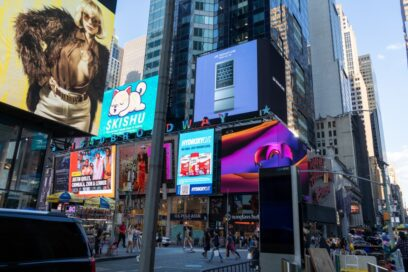 LG's digital billboard in Time Square, New York with an image of LG SIGNATURE Wine Celler against a purple background