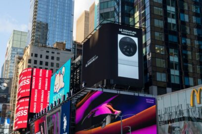 LG's digital billboard in Time Square, New York with an image of LG SIGNATURE Washer and Dryer against a black background