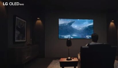 A man watching Netflix in his living room on LG OLED TV