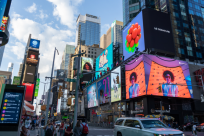 LG's digital billboard in Time Square, New York displaying an animation of plump grapes representing the function of LG SIGNATURE Wine Celler