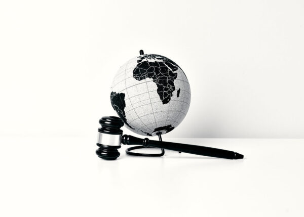 An image of a judge hammer and a globe depicting that LG is taking a firm stance on patent infringement