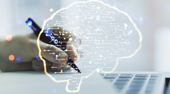 An illustration of a brain with someone writing on paper over a laptop.