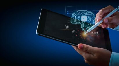 A person using a tablet with an illustration of a brain-shaped circuit emerging from the display.