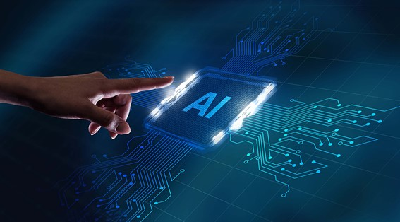 A person pointing at a semiconductor with AI printed on it.