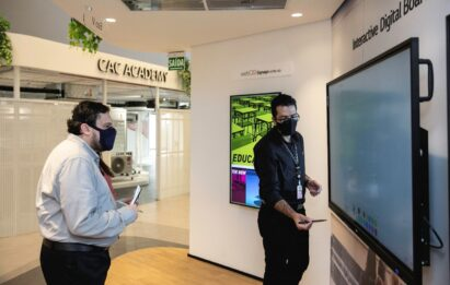 Two men experiencing the Interactive Digital Board installed at The LG Business Solution Center.