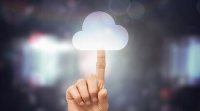 A finger pointing up to an image of a cloud