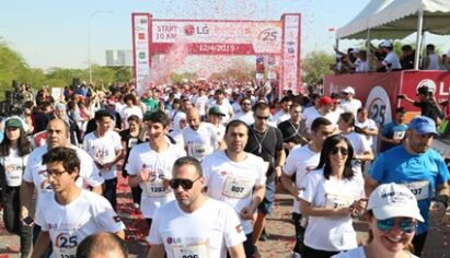 Hundreds of runners crossing the start line at the 2019 LG Dead Sea Half Marathon
