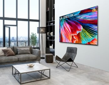 Right-side view of 8K QNED Mini LED TV mounted on the wall of a modern living room