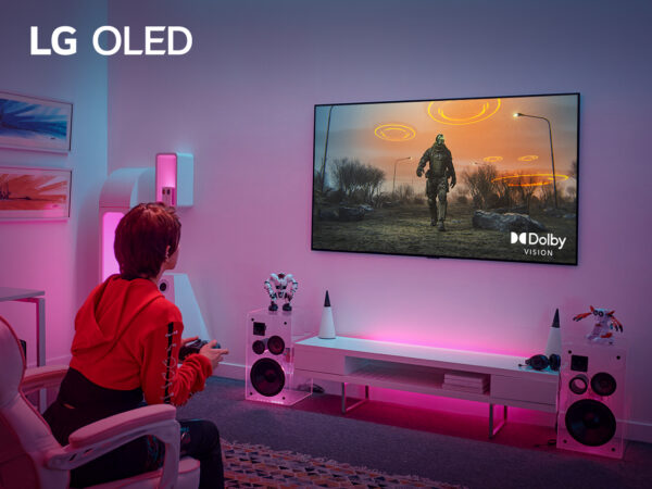 A gamer being completely immersed in a video game at home thanks to LG OLED TV's Dolby Vision at 4K 120Hz