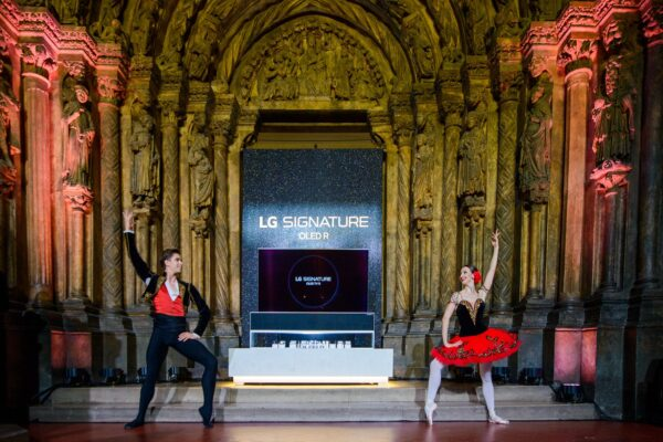 A photo taken during the launch of LG OLED R at the Pushkin Museum with two ballet dancers performing in front of the groundbreaking TV