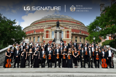 The Royal Philharmonic Orchestra posing outside the Royal Albert Hall with the logos of LG SIGNATURE and the orchestra above