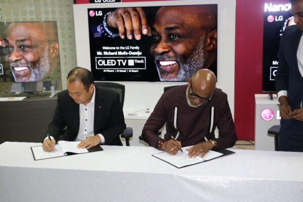 Richard Mofe-Damijo signing up to be LG's newest ambassador.