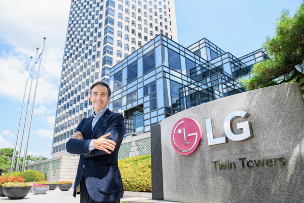Carlos Olave, LG Global HR Leader, posing in front of LG Twin Towers in Seoul