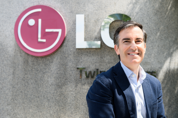Carlos Olave, LG Global HR Leader, posing in front of the LG logo outside LG Twin Towers in Seoul.