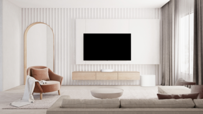 The white LG Éclair and subwoofer placed below a wall-mounted LG TV to effortlessly blend into a white contemporary living room
