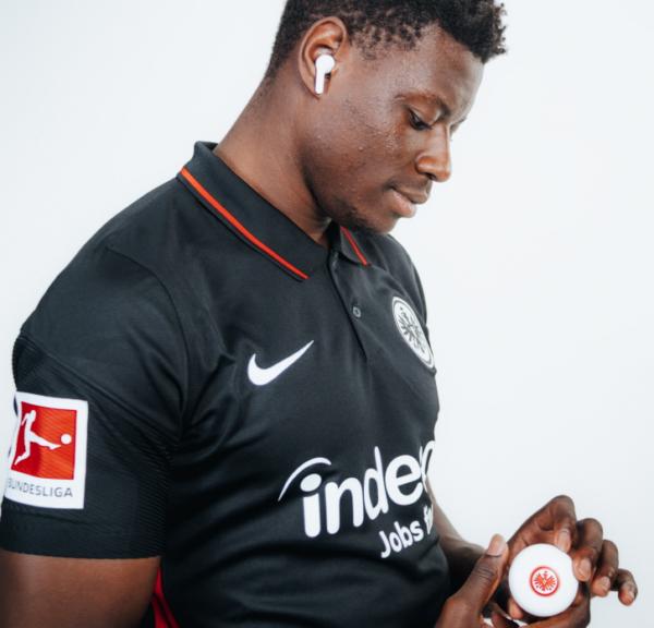 Ragnar Ache, who plays striker for the Bundesliga's Eintracht Frankfurt football club, posing with the Eintracht Frankfurt TONE Free