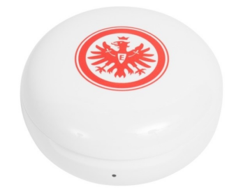 A closeup of the Eintracht Frankfurt TONE Free's charging case with the team's logo displayed on top