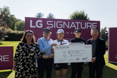 Justine Buisson, Franck Riboud, Ko Jin-young, Park Sung-hyun and Heaven Lee pose with a large check during the golf event to support online charity auction,