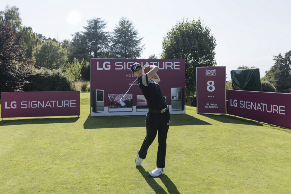 Professional golfer Park Sung-hyun tees off in front of LG SIGNATURE signage.