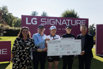 """Justine Buisson, Franck Riboud, Ko Jin-young, Park Sung-hyun and Heaven Lee pose with a large check during the golf event to support online charity auction, """"STRONGER TOGETHER"""""""