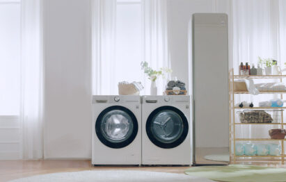 LG washing machine and dryer in a bright expansive utility room next to LG Styler.