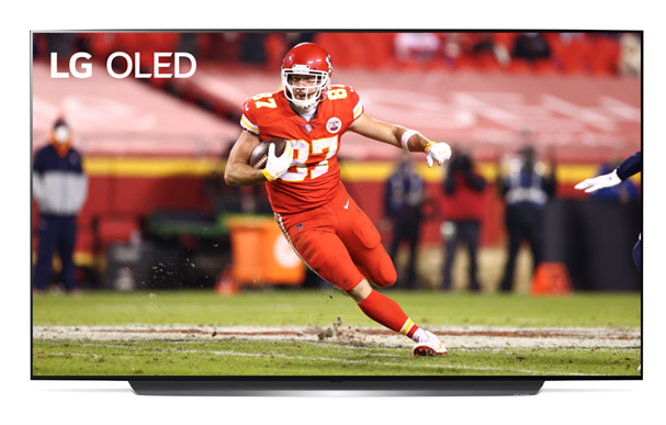 Image of Travis Kelce of the Kansas City Chiefs running the ball during a game displayed on LG OLED TV.