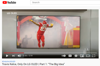 A screenshot from LG's YouTube video featuring Kansas City Chiefs' Travis Kelce dancing as he enters the field.