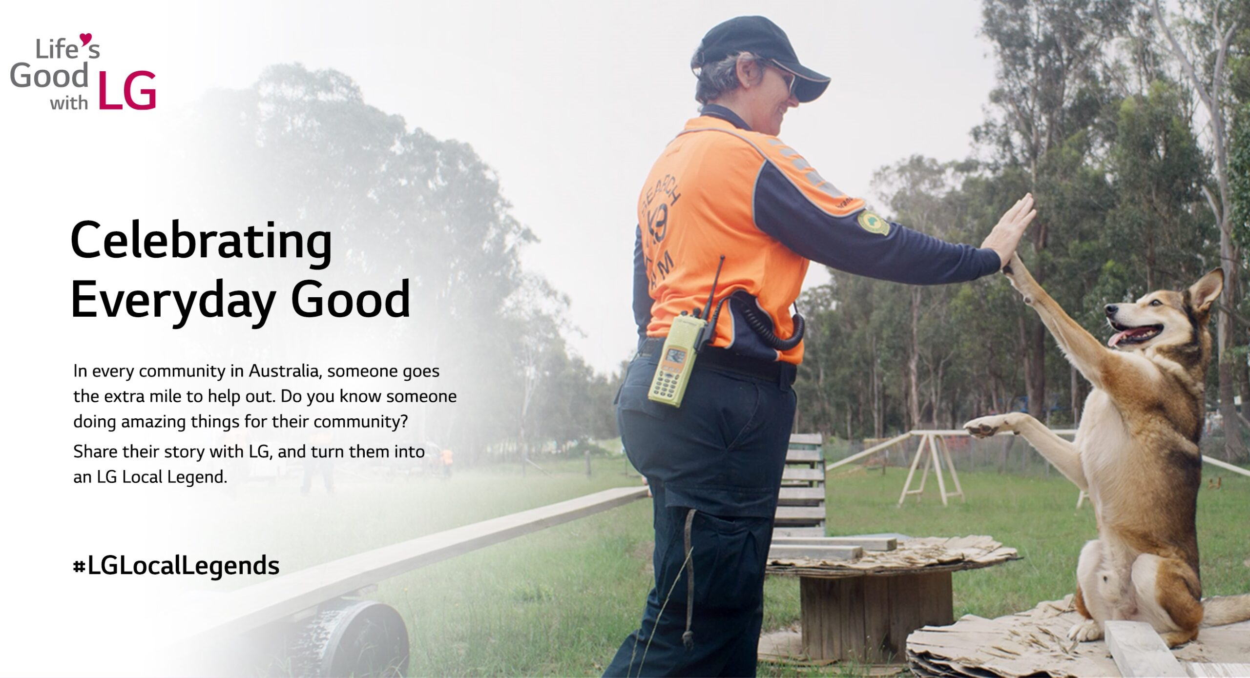 A promotional photo of the LG Local Legends program featuring a search dog and its trainer high fiving.
