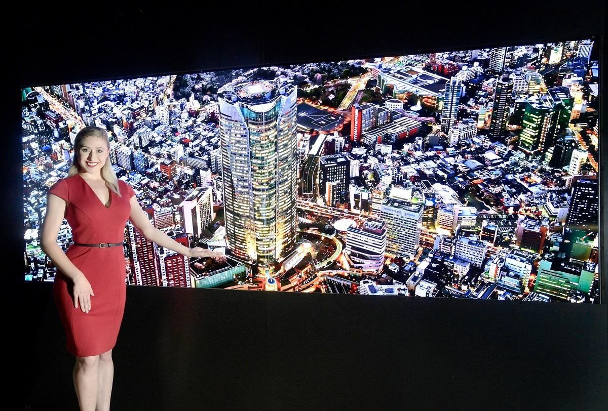A woman presents LG's Micro LED display